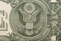 A one dollar bill close up, showing the eagle on the great seal of the United States Royalty Free Stock Photo