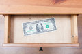 One dollar bill in open drawer Royalty Free Stock Photo