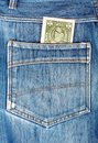One dollar bill sticking in the back pocket of blue jeans Royalty Free Stock Photo