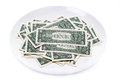 One dollar bills on a plate isolated Stock Images