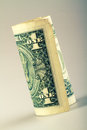 One dollar rolled up u s Royalty Free Stock Image