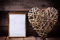 One empty  golden frame and decorative heart with fairy light  o Royalty Free Stock Photo