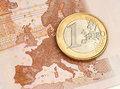 One euro coin on euro banknote showing map of europe Royalty Free Stock Image
