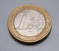 One euro coin on grey background Royalty Free Stock Photo