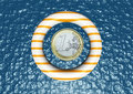 One euro floats in the sea with a life preserver Royalty Free Stock Photography