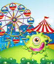 A one eyed green monster at the carnival in the hilltop illustration of Royalty Free Stock Images