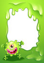 A one eyed green monster in front of an empty template illustration Royalty Free Stock Photos