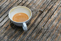 One finished cup of latte coffee on bamboo table Royalty Free Stock Photo