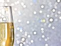 One flute of golden champagne on abstract background silver bokeh with space for text Stock Photos