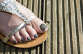 One foot on wooden decking Royalty Free Stock Photos