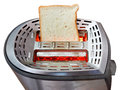 One fresh slice of bread on hot metal toaster isolated white background Stock Photo