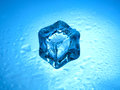 One frozen ice cube with clear water drops on a blue background Royalty Free Stock Photography