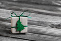 One green christmas present on wooden grey background. Royalty Free Stock Photo