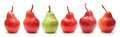 One green pear in a row of red ones Stock Photos