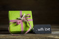 One green present with red white checked ribbon for christmas or