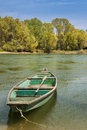 One green wooden boat on the river bank Stock Images