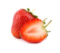 One and a half strawberry on the white background Stock Photography