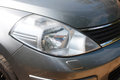 One head light gray car close-up. Royalty Free Stock Photo