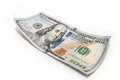 One hundred dollar closeup on white background Royalty Free Stock Image