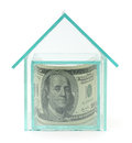 One hundred dollars in glass house on white Stock Images