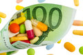 One hundred euro bill and tablets banknote symbolic photo cost of medicine drugs in the pharmaceutical industry Stock Photo