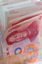 One hundred renminbi bill a stack of rmb or yuan currency and a picture of chairman mao Royalty Free Stock Images
