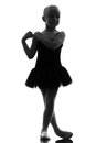 One little girl ballerina ballet dancer dancing si in silhouette on white background Royalty Free Stock Images