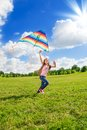 One little girl run with kite happy eight years old beautiful running in the field big color Stock Photo