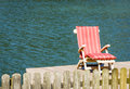 One lounge chair lake Royalty Free Stock Photo
