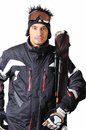 One male skier posing with full equipment on a white background Royalty Free Stock Photo