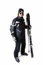 One male skier posing with full equipment on a white background Stock Photography