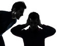One man hearing voices two caucasian young men domination concept shadow white background Royalty Free Stock Photo