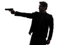 One man killer policeman aiming gun silhouette studio white background Stock Image