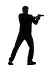 One man killer policeman aiming gun standing silhouette studio white background Royalty Free Stock Photos