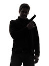 One man killer policeman holding gun portrait silhouette studio white background Stock Image