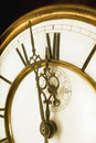 One minute to midnight old clock face with roman numerals Royalty Free Stock Image