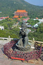 One of The Offering of the Six Devas Buddhistic statues with Po Lin Monastery Royalty Free Stock Photo