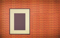 One Old blank photo frame on brick wall Interior Royalty Free Stock Photo