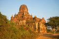 One of the pagodas of the ancient Buddhist temple Tha Kya Pone at dawn. Bagan, Burma Royalty Free Stock Photo