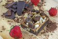 One piece of brownie with chocolate and several strawberries Royalty Free Stock Photo