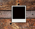 One polaroid photo on wood background Royalty Free Stock Photo