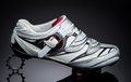 One road cycling shoe standind at small metal sprocket Royalty Free Stock Photo