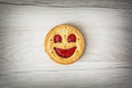 One round biscuit smiling face, humorous sweet food Royalty Free Stock Photo