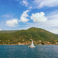 One sail boat. Bay of Kotor, Montenegro Royalty Free Stock Photo