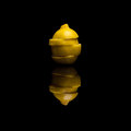 One sliced isolated yellow lemon on black reflective background Royalty Free Stock Photo