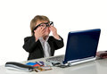 One small little girl (boy) with glasses, computer and credit ca Royalty Free Stock Photography