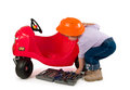 One small little girl repairing toy car. Royalty Free Stock Photos