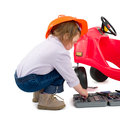 One small little girl wearing hard cap boots repairing toy red car isolated objects Stock Images
