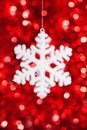 One snowflake toy on red bokeh background Stock Image