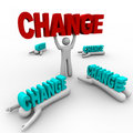 One Stands Holding Change, Others Crushed Royalty Free Stock Photos